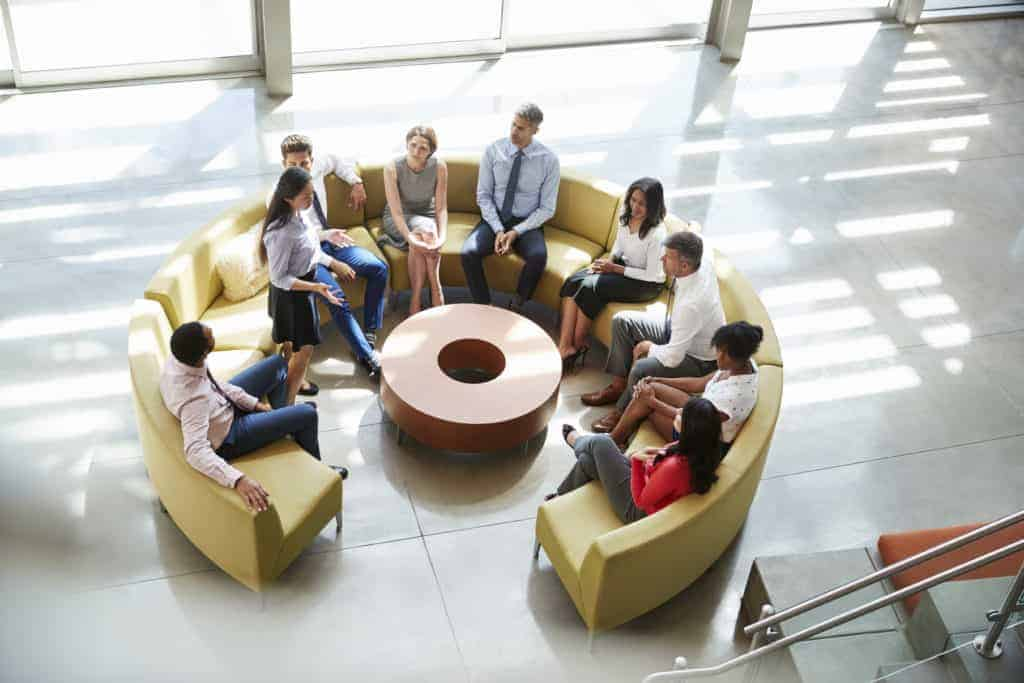 Meeting in a corporate business lounge area, elevated view