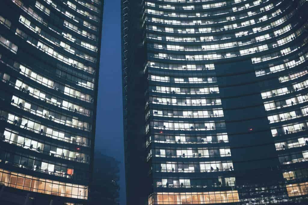Night view of windows offices in a skyscraper in a metropolis - business, offices, finance concept