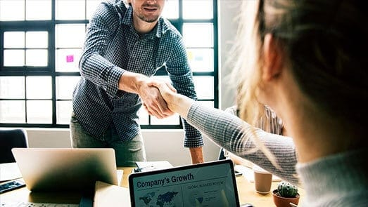 people shaking hands over company growth