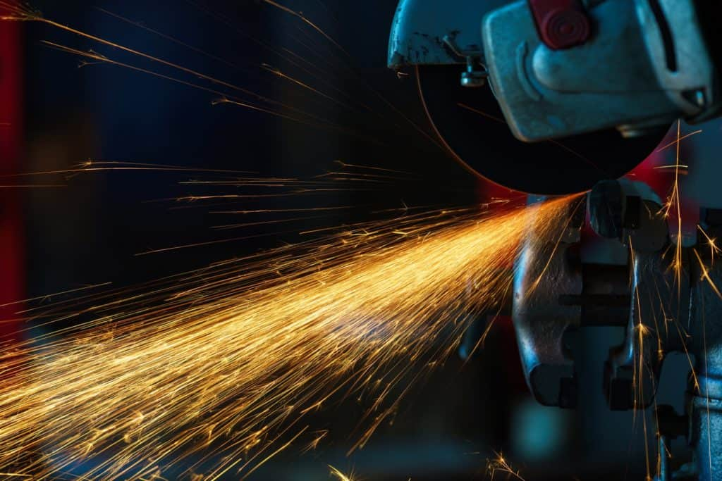 Angular grinding machine is cutting the metal and a lot of spark